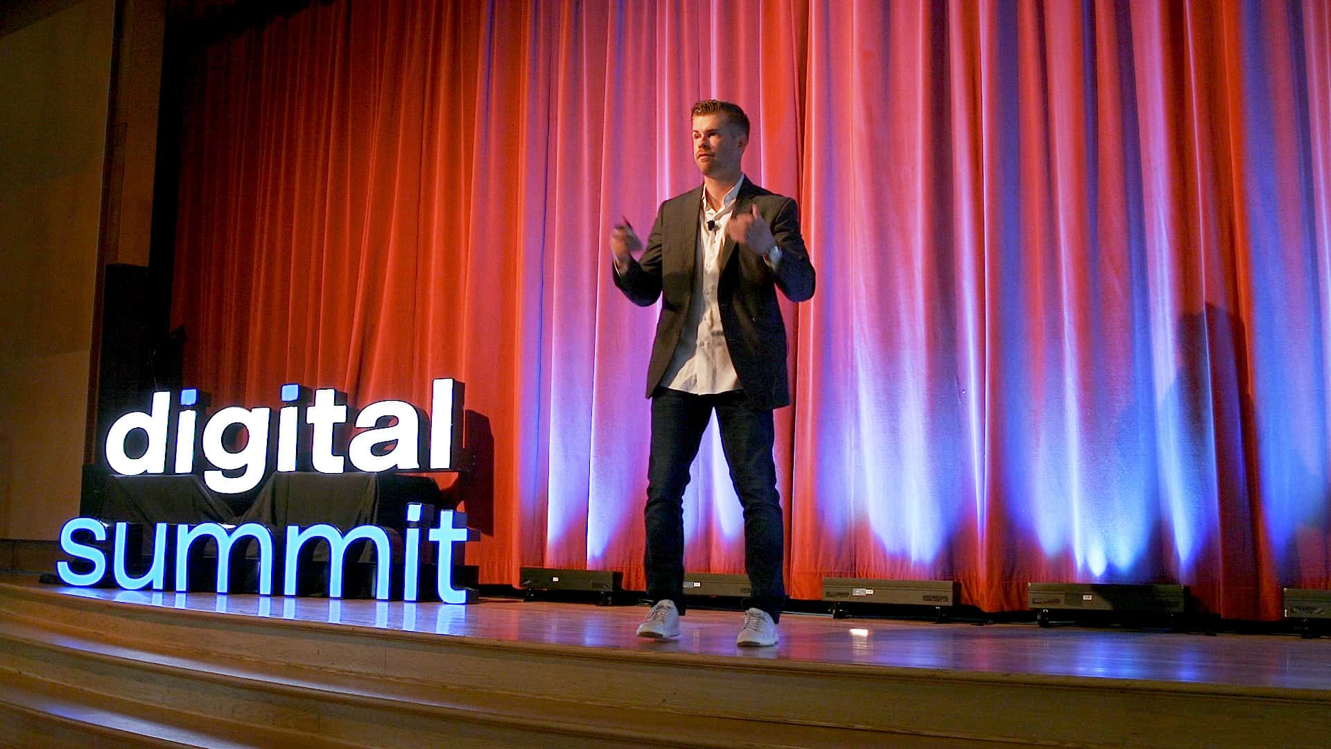 Garrett Mehrguth speaking at Digital Summit in Salt Lake City.